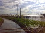 Immagine di Terreni agricoli con sovrastanti serre fisse e precarie con piccoli fabbricati di servizio suddiviso in due corpi dal canale Sarcinelli, libero.